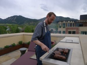 Chef Sean Smith grills steaks at a client's home in Boulder.