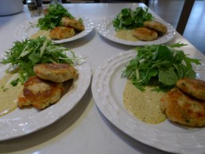 Crab cakes with watercress and mizuna.